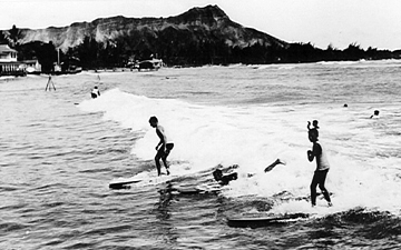 Diamond head waikiki old photo. Surfers surfing.